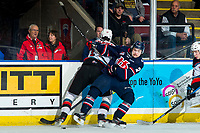 KELOWNA, BC - MARCH 7: Alex Swetlikoff #17 of the Kelowna Rockets is checked by Calen Addison #2 of the Lethbridge Hurricanes during first period at Prospera Place on March 7, 2020 in Kelowna, Canada. (Photo by Marissa Baecker/Shoot the Breeze)