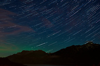 Night Sky, Star Trails, and Northern Lights looking northeast from Haines, Alaska. Composite of images from 01:30 to 01:59 taken with a Nikon D3x camera and 45 mm f/2.8 PC-E lens (ISO 400, 45 mm, f/5.6, 29 sec). Raw images processed with Capture One Pro and the composite generated using Photoshop CC (statistics, maximum).
