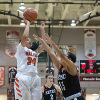 Gallup Bengal Jordan Joe (34) takes a shot as Aztec Tiger Ella Toledo (15) defends Tuesday night at Gallup High School in Gallup. Gallup beat the Tigers 51-11.