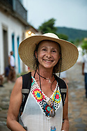 Paraty, Brazil - March 16, 2019: Nancy, from Argentina, visits the Brazilian ttown of Paraty as part of her vacation. Paraty's Portuguese colonial center has cobbled streets and 17th- and 18th-century buildings dating to its time as a port, during the Brazilian Gold Rush.