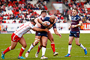 Leeds Rhinos second row Jamie Jones-Buchanan (11) is stopped during the Betfred Super League match between Hull Kingston Rovers and Leeds Rhinos at the Lightstream Stadium, Hull, United Kingdom on 29 April 2018. Picture by Simon Davies.