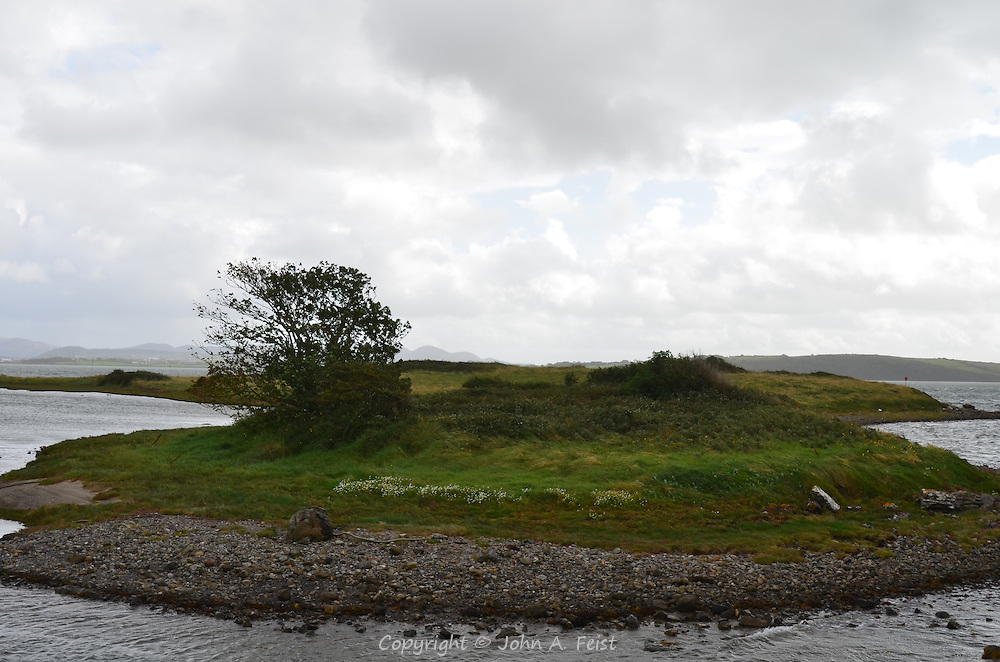 A small island at Sligo, COunty Sligo, Ireland.  The weather that day was very changeable,  dark and rainy in one place and sunny near by.