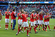 Gareth Bale of Wales © celebrates with his teammates at the end of the match as Wales win 1-0 to book a place in the quarter-finals. UEFA Euro 2016, last 16 , Wales v Northern Ireland at the Parc des Princes in Paris, France on Saturday 25th June 2016, pic by  Andrew Orchard, Andrew Orchard sports photography.