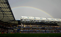 Photo: Daniel Hambury.<br />Chelsea v Portsmouth. The Barclays Premiership. 21/10/2006.<br />Chelsea's and Portsmouth's players play out the game infront of a rainbow.