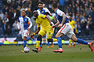 Souleymane Doukara of Leeds United passes the ball under pressure. Skybet football league Championship match, Blackburn Rovers v Leeds United at Ewood Park in Blackburn, Lancs on Saturday 12th March 2016.<br /> pic by Chris Stading, Andrew Orchard sports photography.