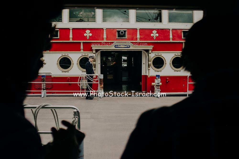 every day Street scene in Japan Passengers onboard a ferry boat