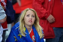 LILLE, FRANCE - Friday, July 1, 2016: A Wales supporter looks tearful as she celebrates the 3-1 victory against Belgium at full time after the UEFA Euro 2016 Championship Quarter-Final match at the Stade Pierre Mauroy. (Pic by Paul Greenwood/Propaganda)
