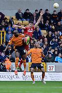 Wolverhampton Wanderers striker Benik Afobe beats Middlesbrough defender Daniel Ayala to a header during the Sky Bet Championship match between Wolverhampton Wanderers and Middlesbrough at Molineux, Wolverhampton, England on 24 October 2015. Photo by Alan Franklin.
