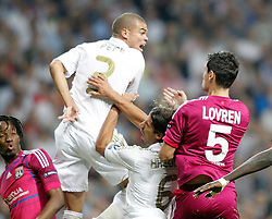 18.10.2011, Santiago Bernabeu Stadion, Madrid, ESP, UEFA CL, Gruppe D, Real Madrid (ESP) vs Olympique Lyon (FRA), im Bild Real Madrid's Sami Khedira collides with Pepe and Dejan Lovren // during UEFA Champions League group D match between Real Madrid (ESP) and Olympique Lyon (FRA) at City of Santiago Bernabeu Stadium, Madrid, Spain on 18/10/2011. EXPA Pictures © 2011, PhotoCredit: EXPA/ Alterphoto/ Alvaro Hernandez +++++ ATTENTION - OUT OF SPAIN/(ESP) +++++
