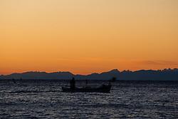 THEMENBILD - ein kleines Fischerboot fährt am 09.10.2011 bei Sonnenuntergang von den Fangplätzen an der slovenischen Adriaküste bei Piran in Richtung Hafen. Zahlreiche Möwen begleiten den Fischer. // A small fishing boat sails on 09.10.2011 at sunset from the fishing grounds on the Slovenian Adriatic coast at Piran in the port. Several seagulls accompany the fisherman. EXPA Pictures © 2011, PhotoCredit: EXPA/ Johann Groder