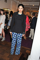 CAROLINE ISSA at the Frocks and Rocks party hosted by Alice Temperley and Jade Jagger at Temperley, Bruton Street, London on 25th April 2013.