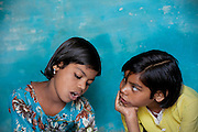 Poonam, 10, (left) and her older sister Jyoti, 11, (right) are studying together inside their family's newly built home in Oriya Basti, one of the water-affected colonies in Bhopal, Madhya Pradesh, India, near the abandoned Union Carbide (now DOW Chemical) industrial complex.