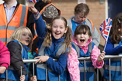 © Licensed to London News Pictures. 12/03/2015. London, UK. Pupils from Grange Primary School wait for the arrival of HRH the Duchess of Cambridge at Ealing Film Studios in west London today to celebrate the success of the award-winning ITV show Downton Abbey. Photo credit : Vickie Flores/LNP