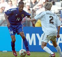 FOOTBALL - CONFEDERATIONS CUP 2003 - GROUP A - 1ST ROUND - NEW ZEALAND v JAPAN- 030618 - ALESSANDRO SANTOS (JAP) / DUNCAN OUGHTON (NZL)  - PHOTO STEPHANE MANTEY / DIGITALSPORT