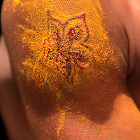 Asia, India, Calcutta. A freshly done flower tattoo covered in pollen to prevent infection.
