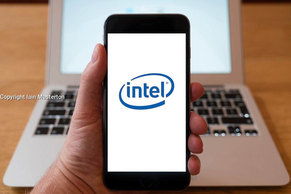 Using iPhone smartphone to display logo of Intel technology company