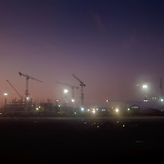 The Airport of Dubai by night, under construction.