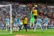Ederson Moraes (31) of Manchester City knocks the ball off off the head of Adrian Mariappa (6) of Watford during the The FA Cup Final match between Manchester City and Watford at Wembley Stadium, London, England on 18 May 2019.