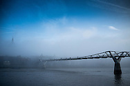 The Met Office has issued a yellow warning for fog over London this morning.<br /> The Millennium Bridge and St Paul's Cathedral over the River Thames earlier today.