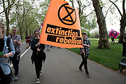 Climate change activists from the Extinction Rebellion group walk up to the Marble Arch camp in protest that the government is not doing enough to avoid catastrophic climate change and to demand the government take radical action to save the planet, on 24th April 2019 in London, England, United Kingdom. Extinction Rebellion is a climate change group started in 2018 and has gained a huge following of people committed to peaceful protests.