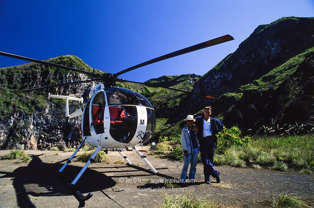 Intan Angkasa MD500 helicopter. Capt. Garret Cloete & friend selling drinks at Mt. Batur crater, Bali, Indonesia.