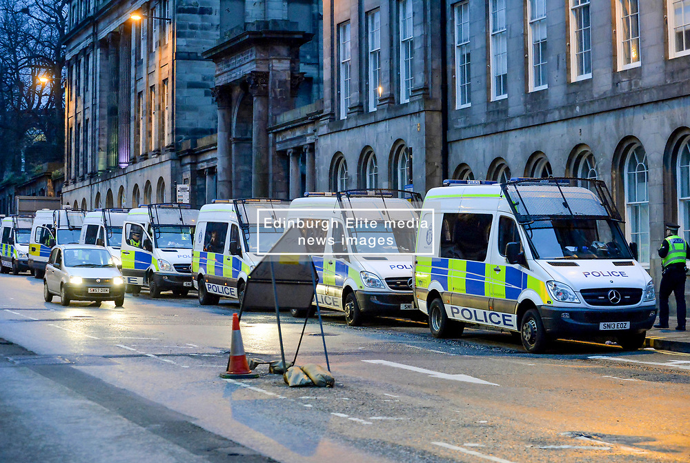Pictured: Into the evening there was still a hard core of protesters, heavily outnumbered by police, who refused to move. Some of the dozens of police vehicles standing by.<br /> <br /> Extinction Rebellion Scotland hosted a demo in which protestors were encouraged to block traffic on North Bridge, Edinburgh, in a bid to highlight the climate change issue, as part of a co-ordinated nationwide action.<br /> <br /> © Dave Johnston/ EEm