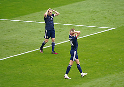 Scotland's Stephen O'Donnell and Jack Hendry look dejected during the UEFA Euro 2020 Group D match at Hampden Park, Glasgow. Picture date: Monday June 14, 2021.