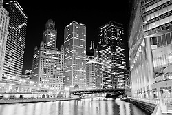 Chicago at night along the Chicago River with office buildings and Irv Kupcinet Bridge (Wabash Avenue Bridge)