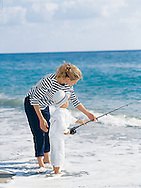 When we produced these images, the crew had a lot of fun playing around in these lifestyle shots. Here a young mom is teachig her little boy how to fish.