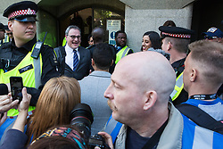 London, UK. 14 May, 2019. Ezra Levant of Rebel Media leaves the Old Bailey following a hearing during which two High Court judges declared that fresh proceedings may be brought against former English Defence League leader Tommy Robinson for an alleged contempt of court over the filming of people involved in a criminal trial.