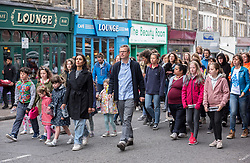 © Licensed to London News Pictures. 29/05/2019. Bristol, UK. HUGH FEARNLEY-WHITTINGSTALL and ANITA RANI take part in filming on North Street in Southville, Bristol, with members of the public campaigning against the use of plastic packaging for the BBC TV series Hugh and Anita's War on Plastic, presented by Hugh Fearnley-Whittingstall and Anita Rani and due for broadcast in June 2019. In Hugh and Anita's War on Plastic celebrity chef Hugh Fearnley-Whittingstall has discovered that mountains of plastic waste from Britain intended for recycling has been shipped 6500 miles to Malaysia then apparently simply dumped or burned. Up to 20-foot high mounds of plastic waste were uncovered by Hugh and Anita Rani as part of the new BBC documentary investigating where our waste goes and if it is being properly recycled. Photo credit: Simon Chapman/LNP.