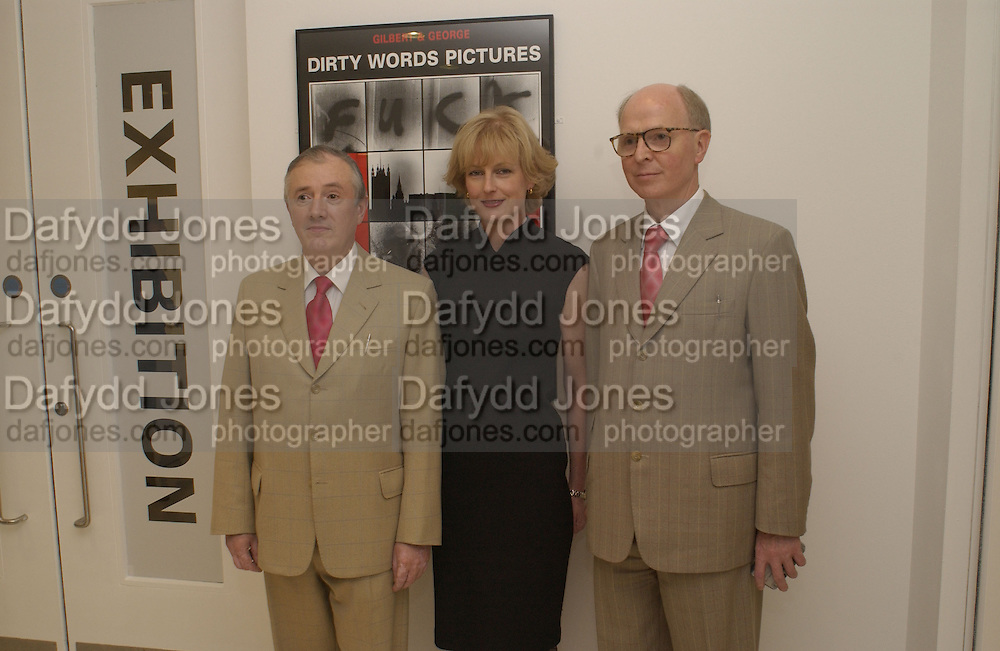 Gilbert and George ( George is taller)  and Julia Peyton-Jones. Gilbert and George the Dirty Words Pictures, 1977. Serpentine. 5 June 2002. © Copyright Photograph by Dafydd Jones 66 Stockwell Park Rd. London SW9 0DA Tel 020 7733 0108 www.dafjones.com