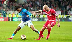 Reiss Nelson of Arsenal takes on Konstantin Rausch of Cologne - Mandatory by-line: Robbie Stephenson/JMP - 23/11/2017 - FOOTBALL - RheinEnergieSTADION - Cologne,  - Cologne v Arsenal - UEFA Europa League Group H