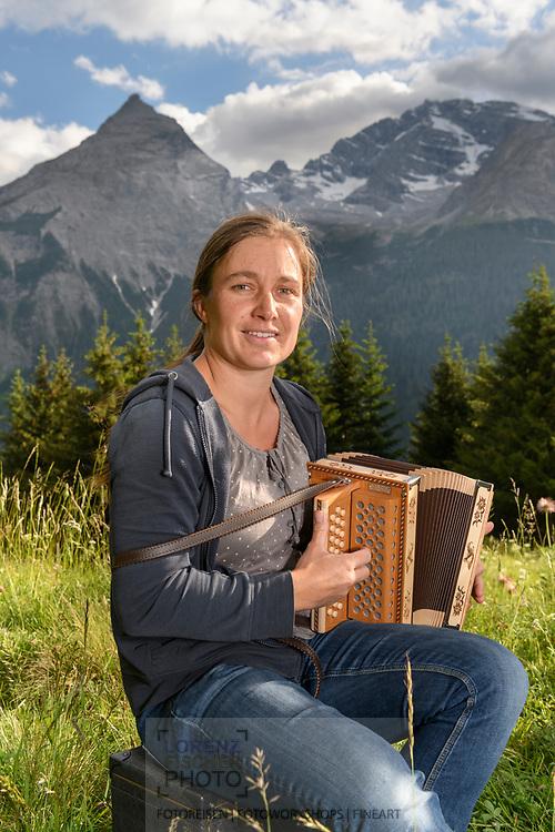 Musician in the shadow of the Piz Ela, Bergün, Parc Ela, Grisons, Switzerland