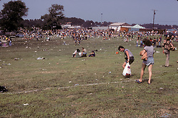 People On the Way to Experience The Grateful Dead Concert at Raceway Park, Englishtown NJ on 3 September 1977. Labor Day Weekend and on The Road into the Show. This shot taken outside the venue leading up to a gate on the west side.
