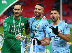 February 25, 2018 - London, England, United Kingdom - L-R Manchester City's Claudio Bravo,Manchester City's Nicolas Otamendi and Manchester City's Sergio Aguero with Trophy.during Carabao Cup Final match between Arsenal against Manchester City at Wembley stadium, London  England on 25 Feb 2018. (Credit Image: © Kieran Galvin/NurPhoto via ZUMA Press)