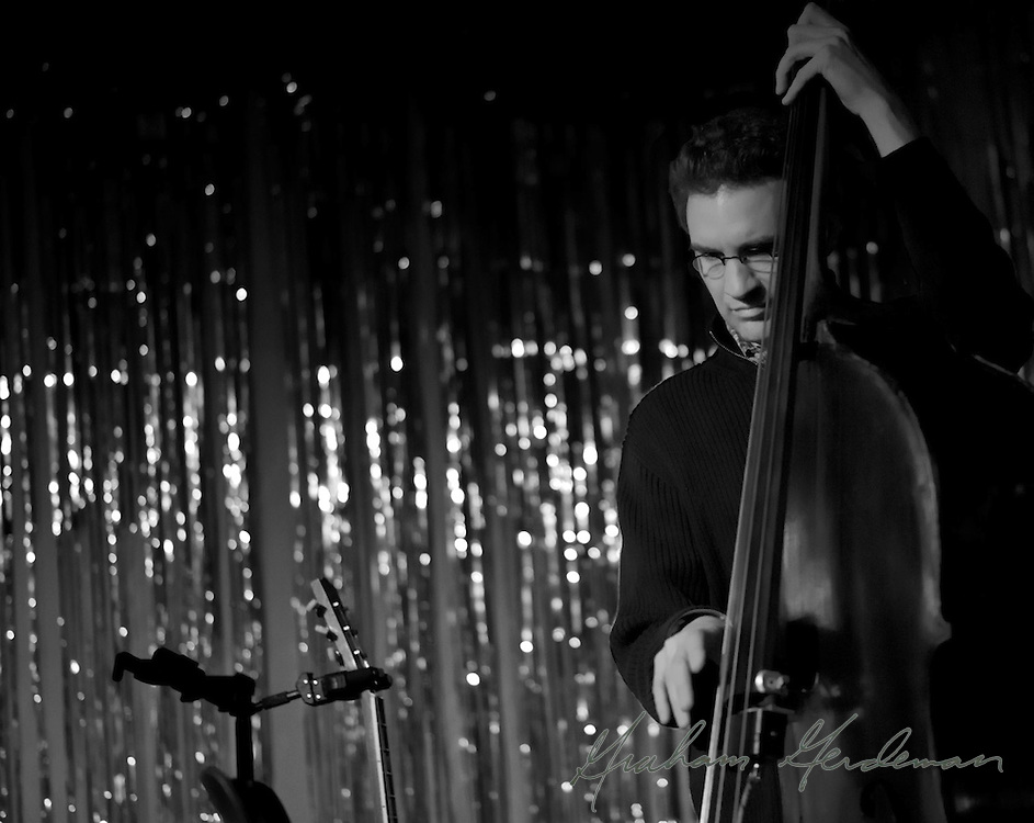 Bassist Viktor Krauss performing with the Jack Silverman Ordeal in Nashville, TN. <br /> <br /> One of several Black and Whites. Stage left was all red light - the images worked much better in black and white.