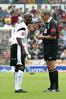 Photo: Dave Linney.<br />Derby County v Norwich City. Coca Cola Championship. 19/08/2006.Referee R Beeby shows the yellow card to Derby's Mo Camara