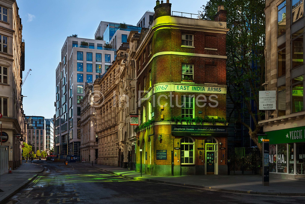 The East India Arms pub in the City of London during the coronavirus pandemic on the 2nd May 2020 in London, United Kingdom. The building is located on Fenchurch Street next to the place where the East India Company had its headquarters. The 1829 building is now the oldest building in the Lloyds Avenue Conservation Area.