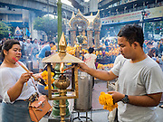 22 AUGUST 2015 - BANGKOK, THAILAND: People light candles and incense in Erawan Shrine Saturday. Erawan Shrine in Bangkok reopened Wednesday, August 19, after more than 20 people were killed and more than 100 injured in a bombing at the shrine Monday, August 17, 2015. The shrine is a popular tourist attraction in the center of Bangkok's high end shopping district and is an important religious site for Thais. No one has claimed responsibility for the bombing.             PHOTO BY JACK KURTZ