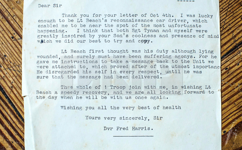 ***COPY FOUND HERE: https://www.dropbox.com/s/bj4js2ci6ctmtyw/Soldiers.txt *** © Licensed to London News Pictures. 05/02/2014 London, UK. A letter from Driver Fred Harris to Lt Beach's father wishing his son well  after saving his life on a recon mission in northern France in 1944. Photo credit : Simon Jacobs/LNP