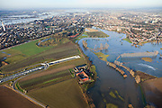 Nederland, Limburg, Roermond, 2011-01-10; Roerdal met riviertje de Roer, ten zuiden van Roermond. Door het hoogwater zijn landerijen onder water te komen staan. Links door beeld de ingang van de Roertunnel..Valley of River Roer, south of Roermond. Because of the high water the land is submerged. High water due to snow melt and precipitation upstream. .Notice entrance tunnel..luchtfoto (toeslag), aerial photo (additional fee required)