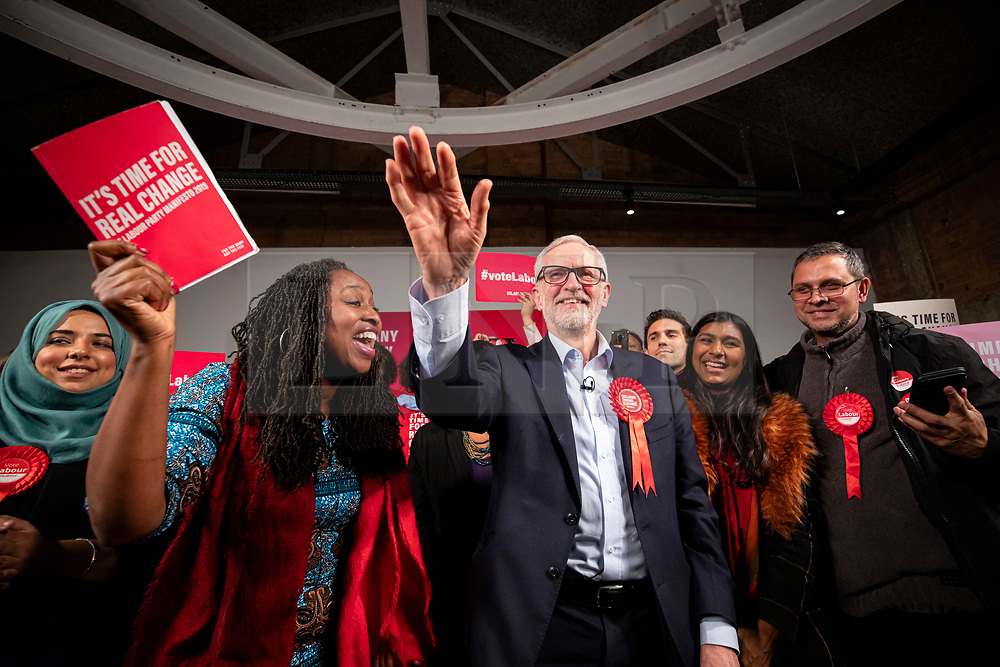 © Licensed to London News Pictures. 11/12/2019. London, UK. Leader of the Labour Party Jeremy Corbyn (centre) on stage with Shadow Women & Equalities Secretary Dawn Butler (L) at the end of the party's final election rally of the campaign. Voters will head to polling stations tomorrow for the 2019 General Election. Photo credit: Rob Pinney/LNP