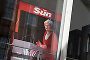 Poster depicting Theresa May MP for the Sun newspaper in the window of their offices in the News Building at London Bridge, London, England, United Kingdom.