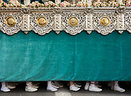 """Tens of costaleros (sack men) are lined up and needed to carry a single float. Each """"paso"""" can weigh hundreds and in cases thousands of kilograms. Granada, Andalusia. Spain"""