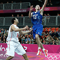 04 August 2012: France Nando De Colo goes for the layup past Tunisia Mohamed Hadidane during 73-69 Team France victory over Team Tunisia, during the men's basketball preliminary, at the Basketball Arena, in London, Great Britain.