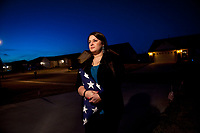 Tulsa, OK -- Jane Horton, 26, standing with the American flag which draped the coffin of her husband Army Specialist Christopher Horton, 26, who was killed in Afghanistan in September 2011, outside of her home near Tulsa, OK. Military leaders worry that after 10 years of war, there is a growing disconnect between the tiny minority of Americans on the battle lines and the vast majority who live their lives in peace.  Photo by Jack Gruber, USA TODAY