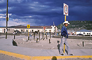 """A man waits for the arrival of the """"Chihuahua al Pacifico"""" train in Posada Baranca, Mexico."""