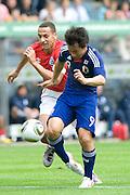 (L to R) Rio Ferdinand (England), Shinji Okazaki (Japan), May 30, 2010 - Football : World Cup South Africa 2010 test match ,  match between Japan 1-2 England  at Libenau stadium, Graz, Austria, (Photo by Enrico Calderoni/AFLO SPORT) [0391]