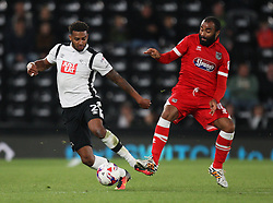 Cyrus Christie of Derby County (L) and Dominic Vose of Grimsby Town in action - Mandatory by-line: Jack Phillips/JMP - 09/08/2016 - FOOTBALL - iPro Stadium - Derby, England - Derby County v Grimsby Town - EFL Cup First Round